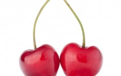 Two heart shaped cherry berries